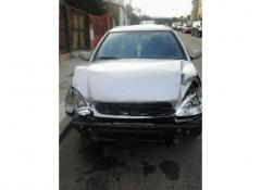 Coche citroen xsara break gris con golpe frontal
